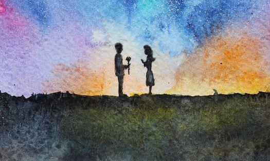 虹色の空とカップル