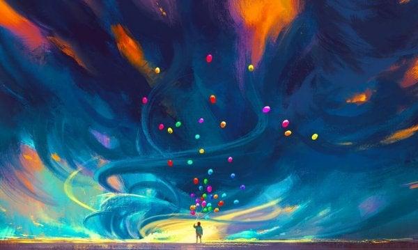 空に昇る虹色の風船