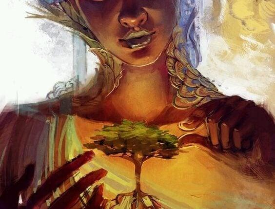 一本の木を手に取る女性