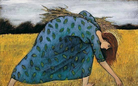 麦を収穫する女性
