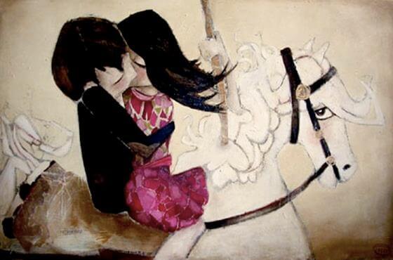 キスをする白馬に乗ったカップル