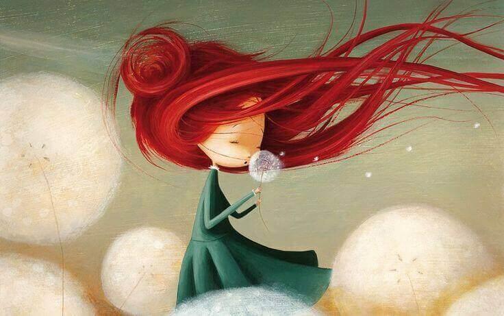 タンポポの綿毛と赤毛の少女