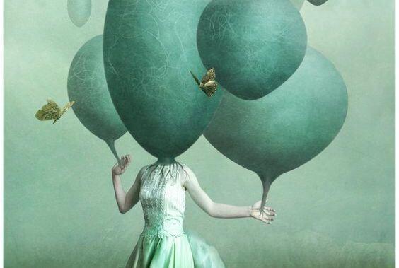 頭が緑の球体の女性