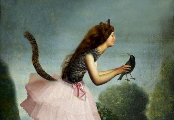 鳥を捕まえる猫の少女
