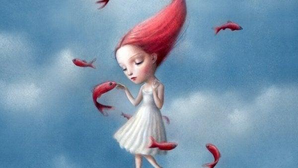 赤い髪の少女と魚