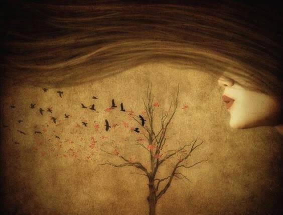 木に息を吹きかける女性