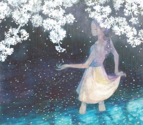花の下の水の中に立つ少女