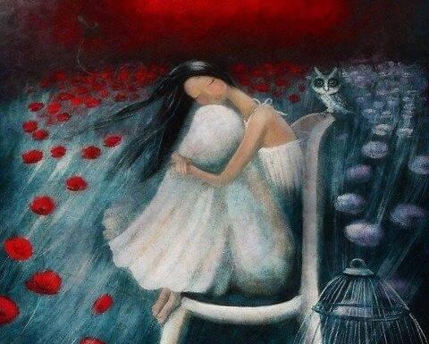 花畑で膝を抱える少女