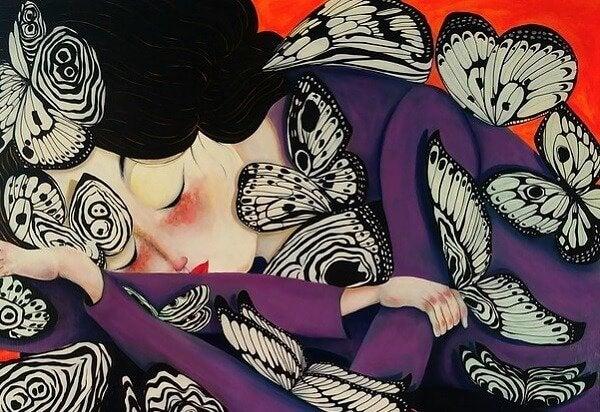 蝶に囲まれた女性