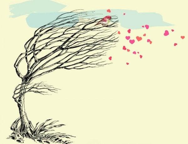 ハートの落ち葉と風に吹かれる木