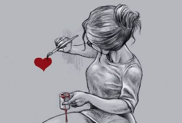 ハートを塗る女性