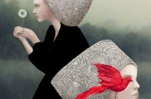 タンポポの綿毛を持つ女性