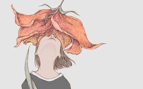 大きな花を見上げる少女