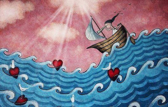 船に乗る少女と海に浮くハート
