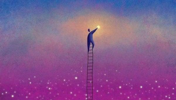 梯子で星に手を伸ばす人