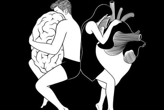 脳を抱く男と心臓を抱く女性