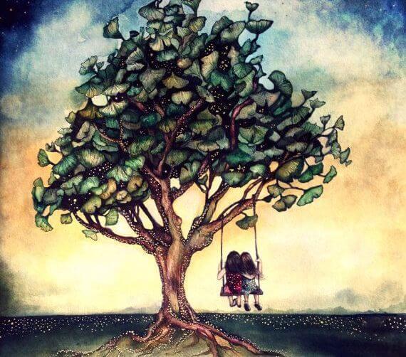 木のブランコに乗る二人の少女