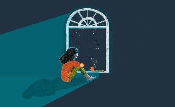 窓から夜空を眺める少女