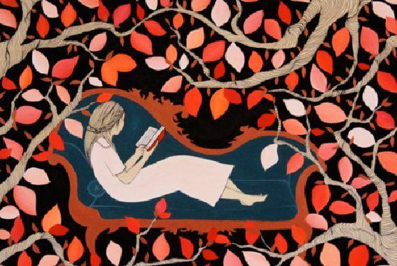気に囲まれて本を読む少女