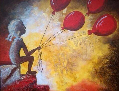 赤い風船を手にする子供
