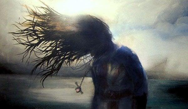 風に吹かれる女性の影