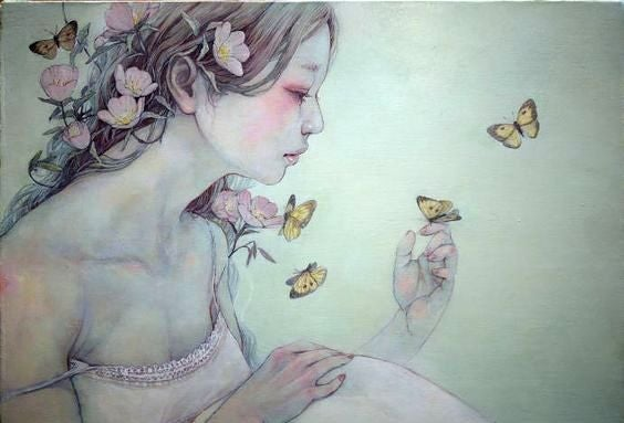 蝶に囲まれた少女