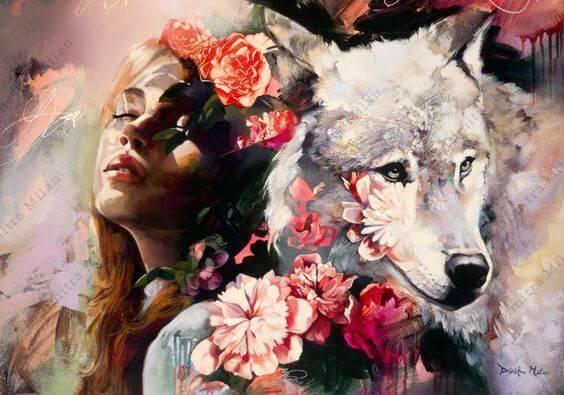 目を閉じる女性とオオカミ