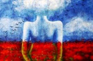 赤い花畑に映る女性の影