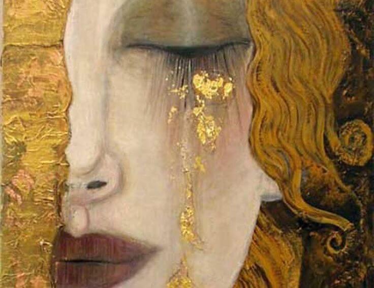 金の涙を流す女性