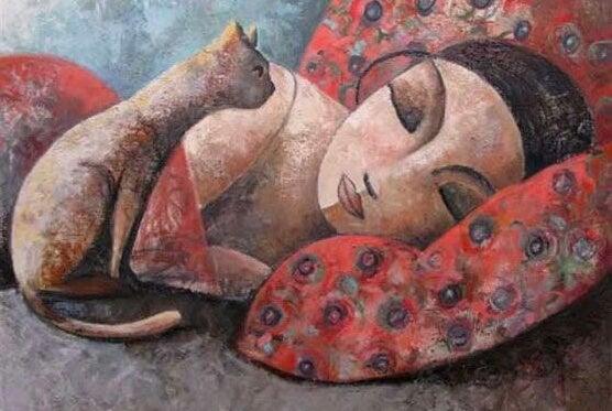 眠る女性と猫