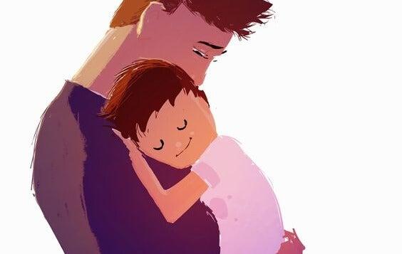 父親に抱かれる息子