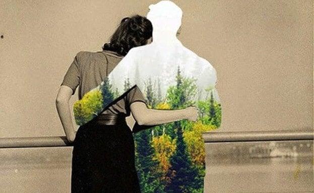 森が映った男性の影と抱き合う女性