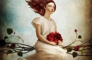 赤い花を持つ女性