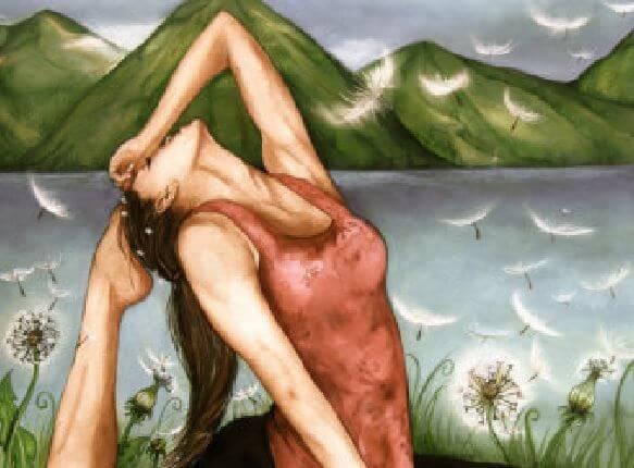 水辺でヨガをする女性