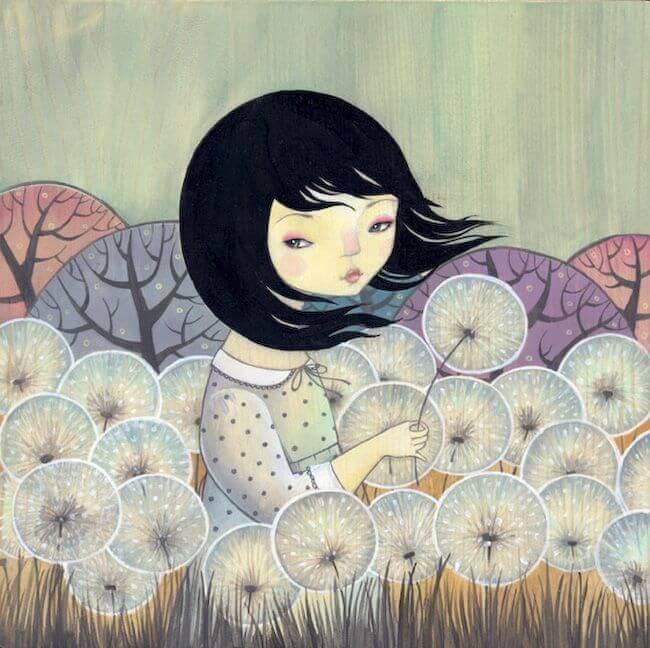 タンポポの綿毛の中の少女