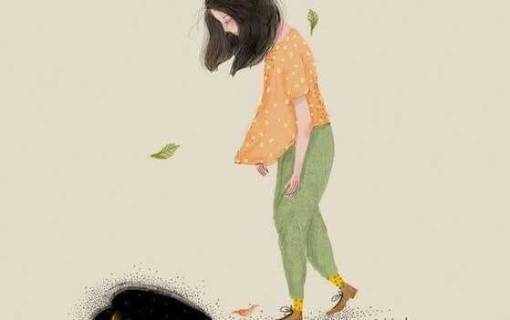 うつむいて歩く女性