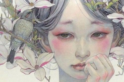花と一羽の鳥に囲まれた白い女性