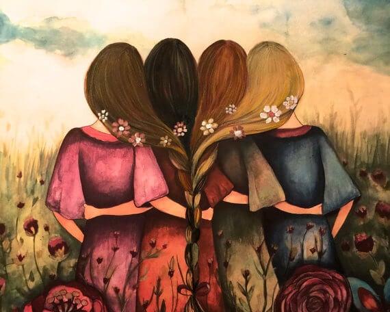 髪を一つに束ねる四人の女性