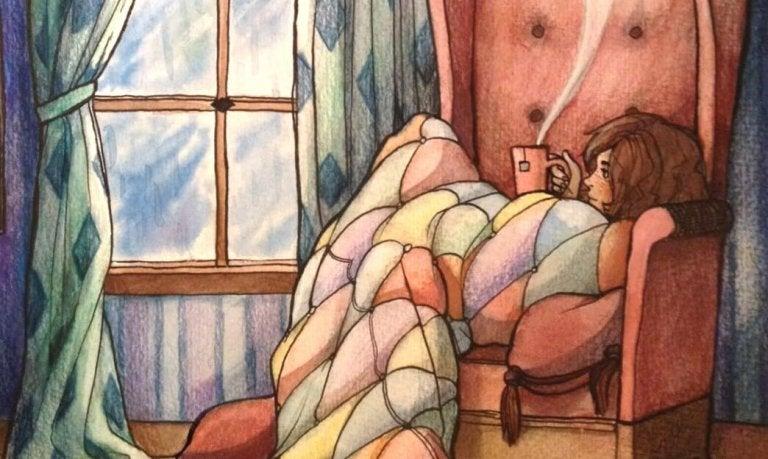 ソファーで毛布にくるまる女性