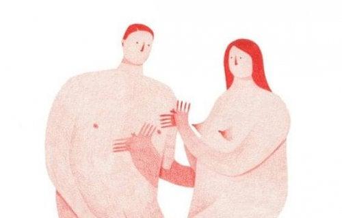 手を取り合う裸の男女