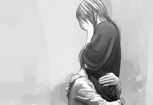 泣く女性をハグ