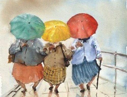 傘をさす3人の老人