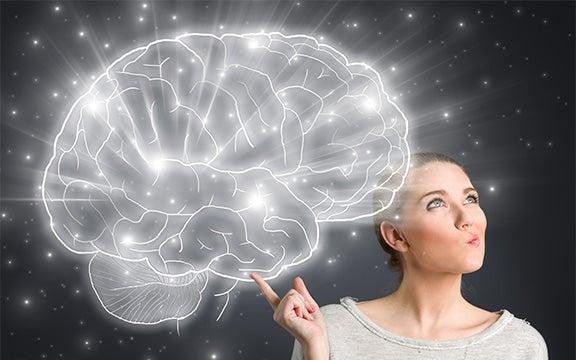 考える女性の脳