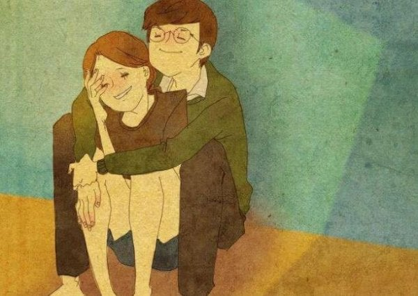座って彼女を抱きしめる男性