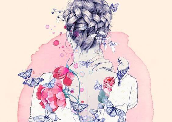 女性の背中に映る花、蝶、鳥
