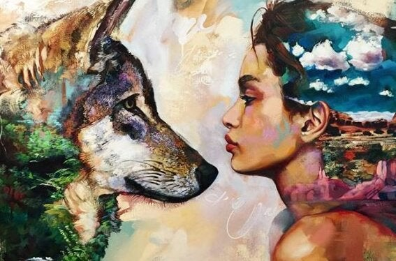オオカミと向き合う女性