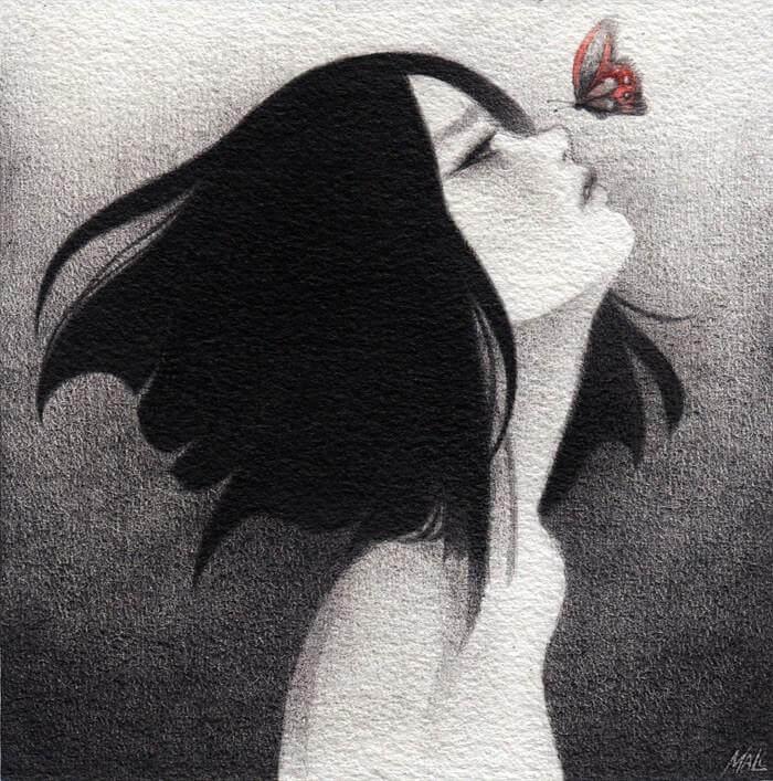上を向く少女と鼻の上を飛ぶ蝶