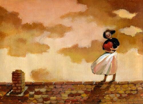 屋根の上でハートを抱える女性
