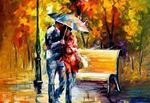 傘をさして歩くカップル