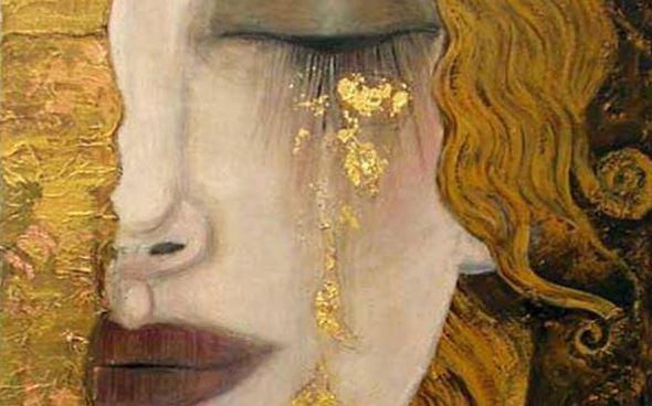 金色の涙を流す女性